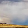 storm and rainbow over prairie