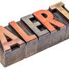 alert word in vintage wood type
