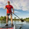 senior athletic paddler on paddleboard