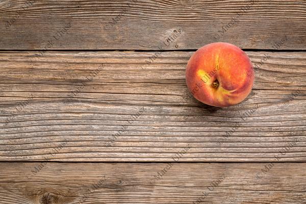 peach fruit on weathered wood