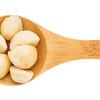 macadamia nuts on wooden spoob