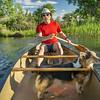 canoe paddling with dog