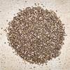 chia seeds pile against rustic wood