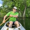 senior male paddler in canoe