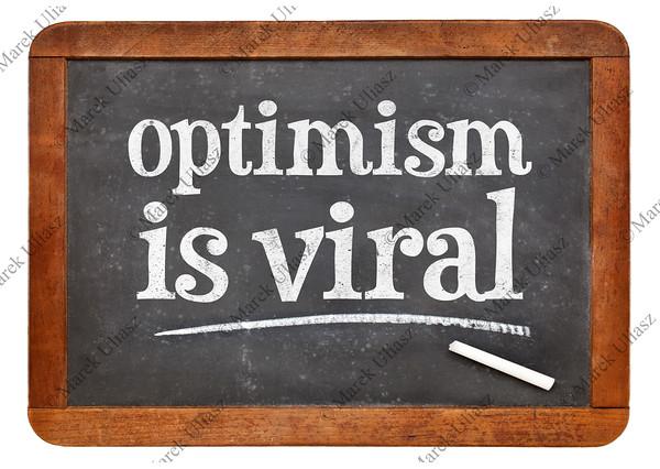 optimism is viral - text on blackboard