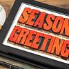 season greetings in wood  type