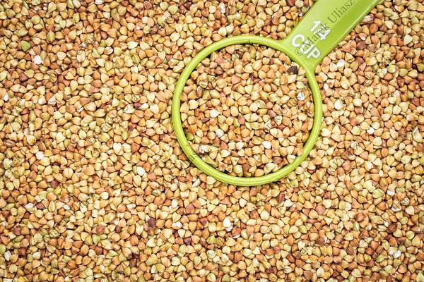 measuring cup of buckwheat