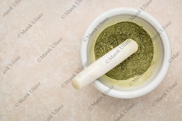 stevia leaves crushed in mortar