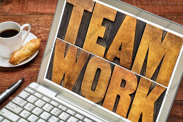 teamwork word typography on laptop