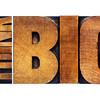 think big in old grunge wood type