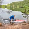 senior paddler launching paddleboard