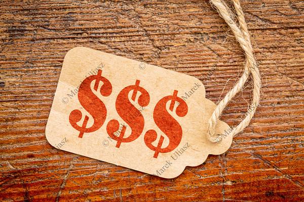triple dollar sign - price tage