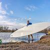 launching stand up paddleboard