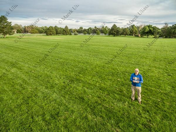 drone operator in green field