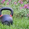 heavy kettlebell in backyard