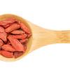 goji berries on wooden spoon