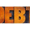 debt word in wood type
