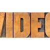 video word in wood type