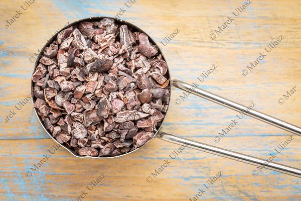 raw cacao nibs in metal scoop