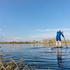 Senior male on SUP paddleboard