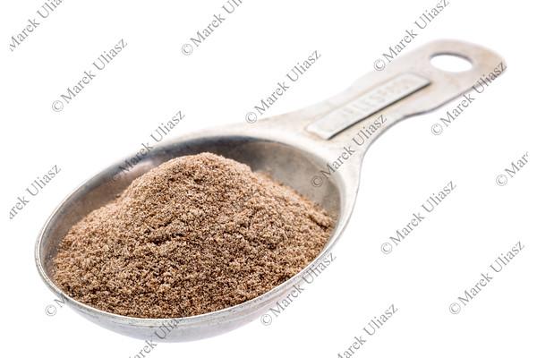 teff flour on measuring spoon