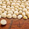 macadamia nuts on rustic wood