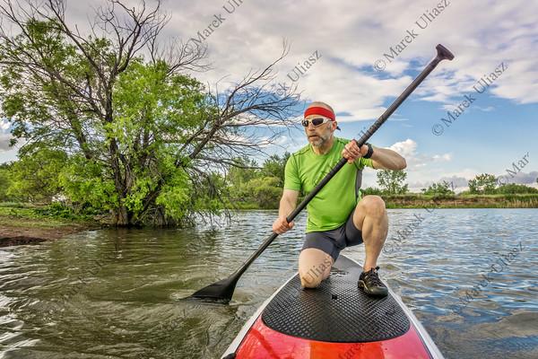 stand up paddling on lake