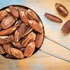 pili nuts in metal scoop
