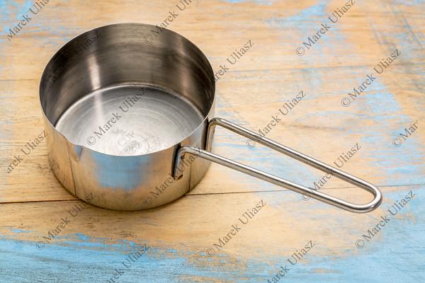 empty metal measuring scoop