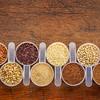 gluten free grains - scoops on rustic wood