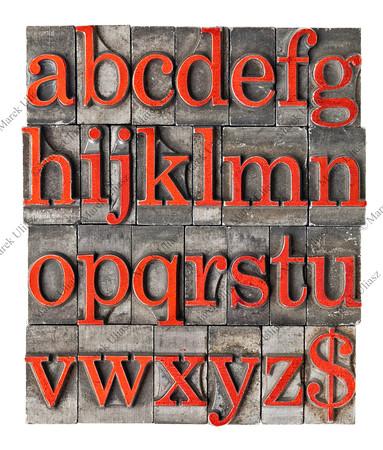 alphabet in grunge metal type