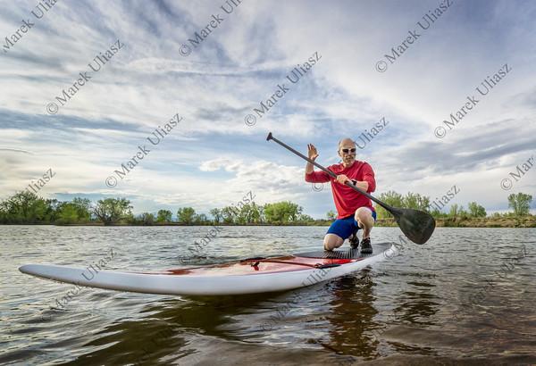 senior male paddler on SUP paddleboard