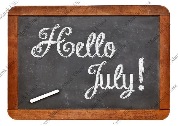 Hello July sign on blackboard