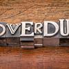 overdue word in metal type