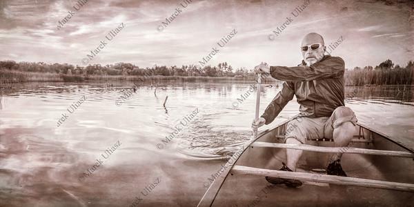 paddling canoe at sunset