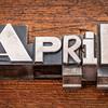 April word in metal type
