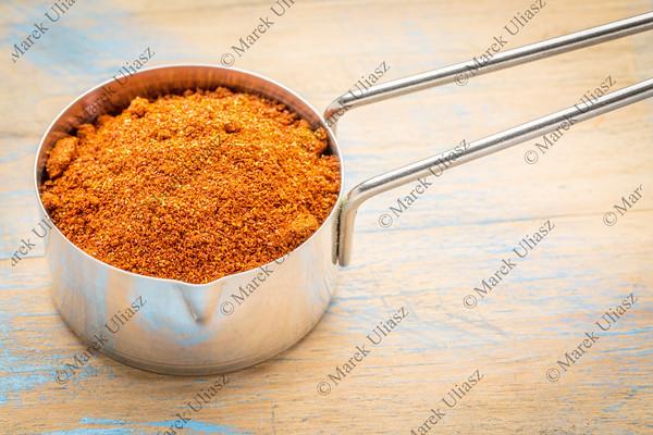 paprika powder on measuring scoop