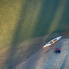 aerial view of canoe on river shore