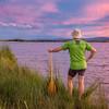 canoe paddler and sunset sky