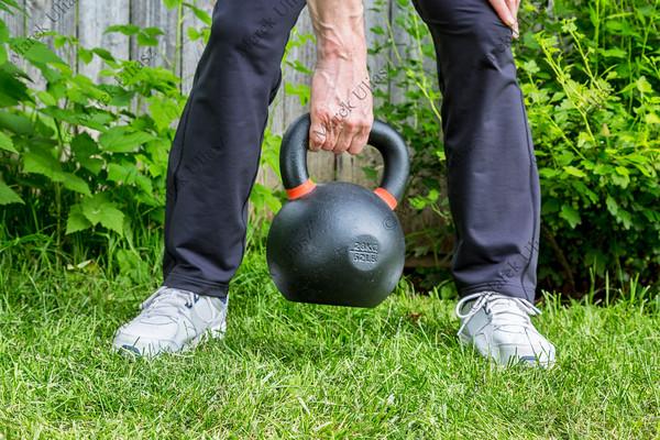 kettlebell workout in backyard