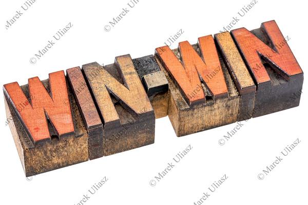 win-win banner in wood type