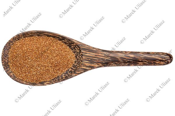 teff grain on wooden spoon
