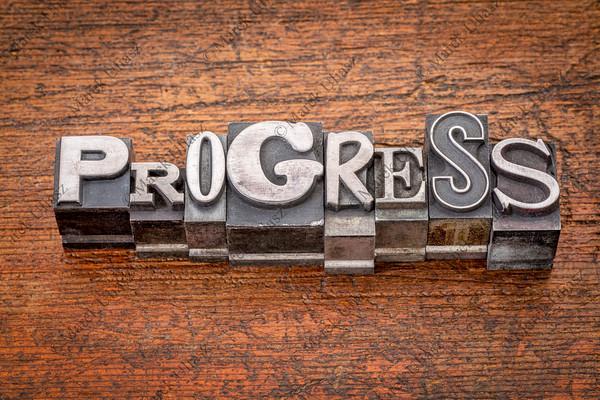 progress word in  metal type