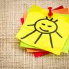 smiling sun on sticky note