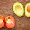 avocado and tomato cut in half