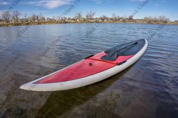 SUP paddleboard on lake shore