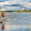 senior male SUP paddler on lake