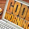 good morning in wood type on laptop