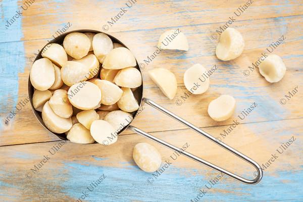 macadamia nuts in metal scoop