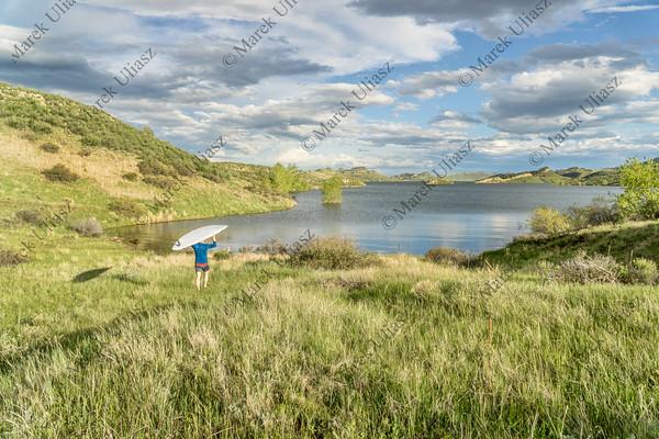 lake landscape with SUP paddleboard